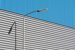 Street lamp and a bue and grey wall (Jan van der Wolf) Tags: map169149v denhaag binckhorst lines playoflines interplayoflines lijnen lijnenspel grey grijs blauw blue gevel facade streetlamp streetlight shadow shadowplay schaduw straatlantaarn composition compositie industrial