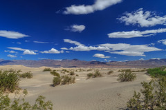 Great Day for a Hike in the Dunes (aparlette) Tags: nationalpark landscape deathvalleynationalpark circularpolarizer bluesky clouds deathvalley desert mesquiteflatsanddunes mountain sanddune vacation stovepipewells california unitedstates us