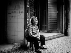 Thinking of Old Macau (Feldore) Tags: macau street candid old woman sitting hongkong step contemplation elderly feldore mchugh em1 olympus 1240mm mono blackandwhite