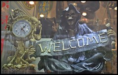 A warm '' Welcome '' from the other side.........of the window ! (fdlscrmn) Tags: window welcome skulls death 7dwf spooky creative nikkor clock advertising banner crime bucharest