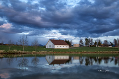 Barn & Stormy Clouds (Explore #219 24/4/17) (Canon Queen Rocks (1,370,000 + views)) Tags: structure barn buildings farm trees clouds reds sky stormclouds reflections lake bozeman montana usa scenery scenic landscape landscapes outdoors water lens