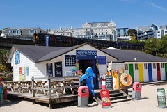 Porthminster Beach Shop and the St Ives Branch line train (zawtowers) Tags: summer holiday ice beach sunshine june st shop train back seaside bucket warm cornwall branch break cream railway line porth ia heading ives essentials spade kernow erth porthminster 2013