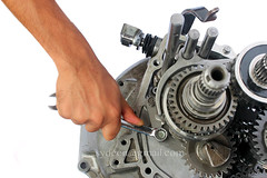 gearbox repairing (sydeen) Tags: auto white car metal tooth drive movement automobile shiny iron industrial hand control arm geometry metallic finger background parts garage engine machine engineering gear repair motorcycle vehicle material motor accessories geometrical spare concept metaphor engineer transmission shaft gearbox teamwork spanner crankshaft