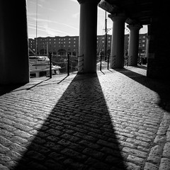 Shadows and light (Bev Goodwin) Tags: light urban blackandwhite architecture liverpool square shadows cobblestones cobbles albertdock blackwhitephotos sonyslta65v