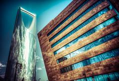 Hagbani Building (Faisal Bin Zarah) Tags: road street blue sky clouds structure saudi arabia riyadh mobily