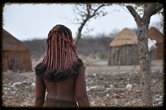 Entering the Village (The Spirit of the World ( On and Off)) Tags: village huts braids tribe namibia autofocus himbawoman africantribe himbavillage rememberthatmomentlevel4 rememberthatmomentlevel1 rememberthatmomentlevel2 rememberthatmomentlevel3 rememberthatmomentlevel5 northernamibia