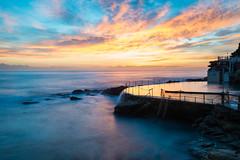 Bronte Sunrise (sebr) Tags: ocean longexposure blue pool silhouette yellow clouds sunrise rocks bronte oceanpool