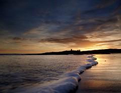 Dunstanburgh Dawn (Amble180) Tags: wild sunrise lumix cloudy panasonic northumberland about g3 dunstanburgh 1442