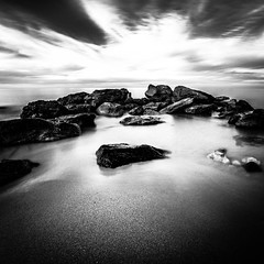 Sidna Youcha, Tlemcen, Algrie (Samere Fahim Photography) Tags: longexposure light sea sky blackandwhite bw sun black beach rock clouds canon square landscape photo