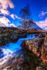 Blue wild cascades (lubosbruha) Tags: blue sky mountain tree water clouds river landscape geotagged scotland waterfall highlands glencoe buachaille gbr buachailleetivemor dalness velkábritánie fortwilliamandardnamurchanward fortwilliamandardnamurchanwa coupalriver geo:lat=5664764500 geo:lon=486708400