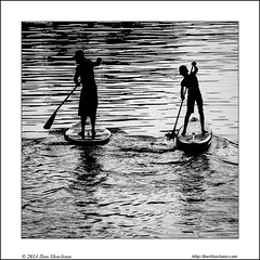 Man and Child paddling (Ilan Shacham) Tags: boy sunset blackandwhite bw man sports water reflections square togetherness israel telaviv child tranquility together serenity excercise sup bonding yarkon standuppaddlerboard standuppaddlersurfer