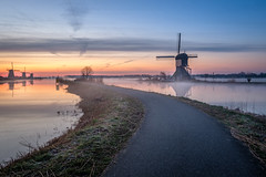 Path through windmill city (Mario Visser) Tags: windmill path kinderdijk unesco sunruse color fujifilm xt2 netherlands water road dutch