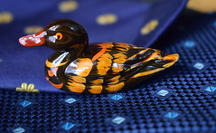 Porcelain duck swimming on silk tie (Sriini) Tags: mondaymacro glaze monday macro porcelain swimming silky tie river blue chinaware minature duck explore silk