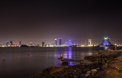muharaq bay (azahar photography) Tags: arab arabia architecture asia bahrain bay bfh block blue boat building business centre city day east financial flag glass gulf harbor harbour high highway landmark light manama middle modern muharaq night office rise sea skycrapper skyline skyscraper tall tower trade traditional tree vehicle