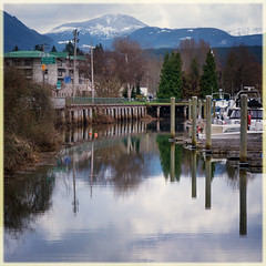more small town reflections (marneejill) Tags: wooden posts bridge mountain ocean reflections dock boats port alberni