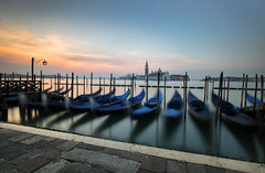 Gondolas (the CAMera of ian CAMpbell; simple) Tags: venice italy venetian camcam chiesa di san giorgio maggiore gondola gondolas long exposusre sun sunrise church tower