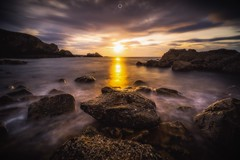 Spotlight on the Rocks (Augmented Reality Images (Getty Contributor)) Tags: canon cliffs clouds colours dusk landscape leefilters longexposure morayfirth portknockie rocks scotland sunset water waves