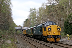 """37025 """"Inverness TMD"""" - Sutton Park (Andrew Edkins) Tags: vstppath inspectionsaloon testcoach caroline photograph photo travel trip crossing staffordshire naturereserve park diesel loco locomotive 37025 invernesstmd class37 tractor suttonpark graffiti footcrossing suttoncoldfield largelogo britishrail br bridge railwayphotography westmidlands trees geotagged england uk englishelectric syphon growler carriages splitheadcode sky afternoon 5z37 type3 canon light streetlygate 2017 april"""
