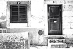 Entrance 27 (Alexander.Hüls) Tags: door blackandwhite bw monochrome numbers lisbon entrance window lisboa city street