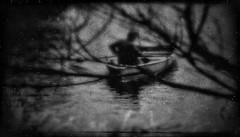 Travels (Lukeman1977) Tags: tree boat water shadow figure blurred dream landscape dark haunting cinematic