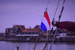 The beginning is the most important part of the work (marcootero_) Tags: sailboat flag netherland holland sea dawn bandera holanda dutch volendam boat velero segelboat