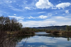 And the Clouds Come Rolling In (Patricia Henschen) Tags: chatfieldstatepark chatfield littleton colorado clouds wetland pond reflection mountain mountains rampart range
