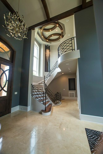 Curved staircase, metal railing