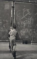 Vota Comunista (Fremdwortlexikon) Tags: children boys blackandwhite schwarzweis foundphoto monochrome italy italia italien kinder playing outside graffiti elezionisenato election