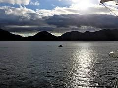 Ketchikan AK ~ evening serenity (karma (Karen)) Tags: ketchikan alaska hollandamerica cruising magichour mountains clouds rays silhouette iphone cliche hcs