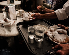 Beignets & Hands (PJ Resnick) Tags: neworleans pjresnick perryjresnick pjresnickgmailcom pjresnickphotographygmailcom ©2017pjresnick ©pjresnick contrast digital light shadow black highspeediso fujifilm fuji fujinon xf resnick rectangle rectangular white filmsimulation nola fujifilmxpro2 xpro2 fujixpro2 street streetphotography frenchquarter 16mm fujinon16mmf14 xf16mmf14 fuji16mm 4x5 cafedumonde foodography beignets hands coffee restaurant classicchrome fujiclassicchrome water glasses glass table napkin