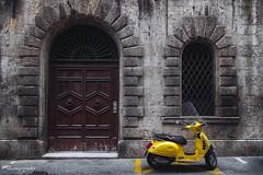ramblings of a door-to-door poet (cherryspicks (on/off)) Tags: street city transport scooter vespa yellow wall stonework door window urban siena tuscany italy moped