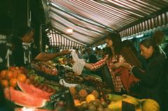 Naschmarkt (florianblang.com) Tags: vienna wien woman film girl analog canon 50mm gold austria 1 österreich europa europe market kodak ae1 crowd 400 f18 18 expired ae naschmarkt fd
