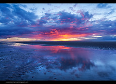 Gods of Fire (Steve-P2010) Tags: uk sunset reflection beach pool evening sand bluesky reflected redsky lowtide northwales lowcloud