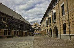 Lines, patterns & arches (Ibraheem Adams) Tags: trees roof sky building brick college lines architecture clouds university pattern arch cloudy pov masonry perspective arches courtyard sidewalk tiles grandrapids checkerboard