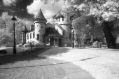 Curwood Castle IR (scott_z28) Tags: blackandwhite bw building castle film monochrome mi ir minolta michigan surreal hc110 historic infrared epson vivitar v300 srt101 hoya efke r72 19mm owosso f38 dilutionb curwood ir820