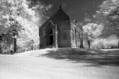 Elm Lawn Cemetery IR (scott_z28) Tags: blackandwhite bw building film church monochrome cemetery mi ir minolta michigan surreal historic infrared vivitar srt101 baycity tricities chappel efke 19mm f38 ir820