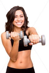Beautiful fitness woman lifting weights (J