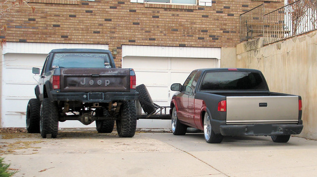 chevrolet truck gm jeep 4x4 low extreme sonoma pickup mini pickuptruck dent odd driveway chevy modified 1980s lowrider gmc 1990s dents s10 jalopy beatup junker slammed beater extremes madeinusa americanmade 2wd fourwheeldrive lifted s15 chev dented minitruck generalmotors 2000s comanche chevys10 bigtires generalmotorscorporation gmcsonoma jeepcomanche oddpanel eyellgeteven