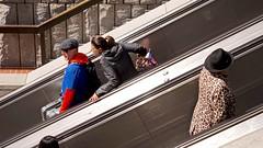 Another Point of View DSC00730 (Lynn Friedman) Tags: bart muni powellstreet entrance escalators men women outside sanfrancisco 94103 favorites favs imagebrief favstock stock fav