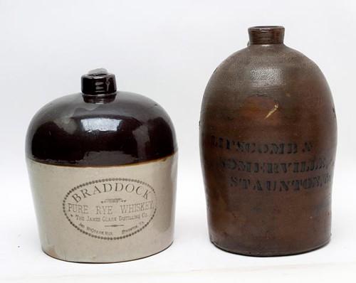 Staunton Merchants Stoneware J. McQuaide Whiskey Jug ($246.40) and Lipscomb and Somerville Jug ($156.80)