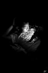 Dangerous globalization! (poupette1957) Tags: art atmosphère black canon city curious children detail game humanisme imagesingulières interior life laos monochrome noiretblanc noir nuit night photographie people portrait rue street town travel urban ville voyage