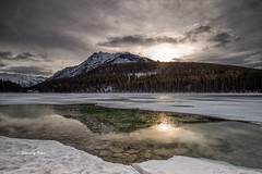 Two Jack Lake (Canon Queen Rocks (1,340,000 + views)) Tags: sky scenery scenic landscape landscapes lake twojacklakes reflections ice frozen melt mountain mountains alberta canada water snow