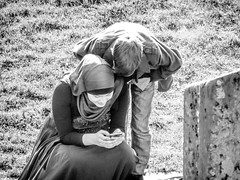 A mother and son (A. Yousuf Kurniawan) Tags: mother children love family blackandwhite monochrome streetlife streetphotography streetphoto citypark activity moslem kid hijab juxtaposition
