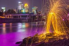 Purple River Sparks (Doug Wallick) Tags: minneapolis mississippi river wool steel sparks purple skyline bridge fire spinning prince