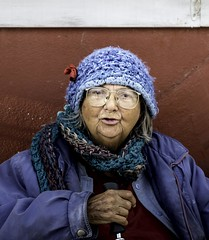 Hey There Good looking (Hugo the Gonzalez) Tags: lady old demoines iowa blue red portrait wrinkles hat cane jacket outside america scarf glasses