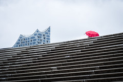April in Hamburg (Ulrich Neitzel) Tags: architecture architektur baumwall elbphilharmonie elphi hamburg mzuiko1250mm olympusem5 rain red regen rot schirm stairs treppe umbrella