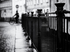 rainy day (Sandy...J) Tags: atmosphere blackwhite city rain biker streetphotography monochrom noir cyclist blurred black white photography street mood olympus