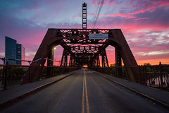 I Street Bridge (boingyman.) Tags: ca bridge light sunset urban color car landscape cityscape crossing lighttrails sacramento scape intensity americanriver istreetbridge boingyman