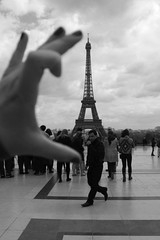 pinch of paris (Emma D'Arpino) Tags: travel blackandwhite bw man paris france canon photography europe hand fingers eiffeltower eiffel nails human april 2012 emmadarpino emmadarpinophotography