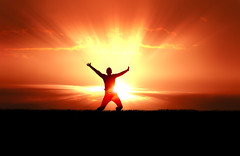 Man Jumping in Sun Rays (trianonsoficial) Tags: life sunset sky orange sunlight man black male nature field grass silhouette horizontal sunrise landscape fun happy freedom jump healthy energy worship colorful reaching pray joy young victory christian celebration achievement figure passion strength rays positive concept satisfaction cheerful spiritual success leap enjoyment praise winning overcome fulfillment accomplishment ecstatic unrecognizable